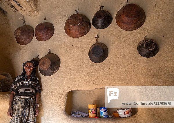 Woman inside her house decorated with leather baskets in a traditional Argoba stone houses village  Harari Region  Koremi  Ethiopia.