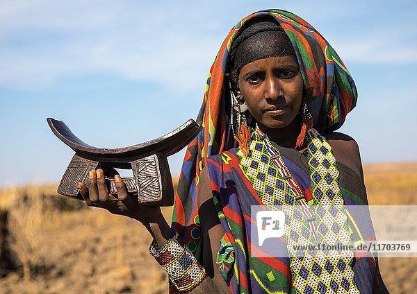 Issa tribe woman with a wooden pillow  Afar region  Yangudi Rassa National Park  Ethiopia.