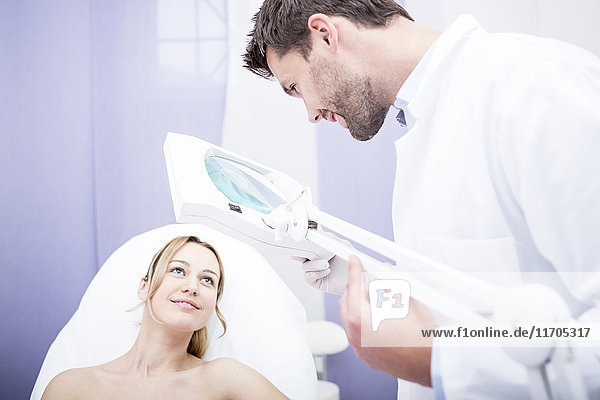 Aesthetic surgery  doctor talking to woman