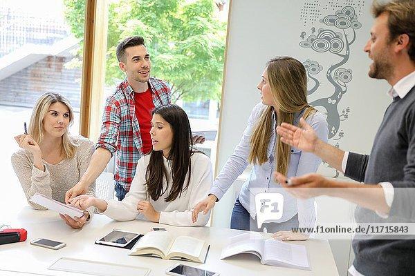 Teacher with group of students doing a joint work  University of the Basque Country  San Sebastian  Donostia  Gipuzkoa  Spain