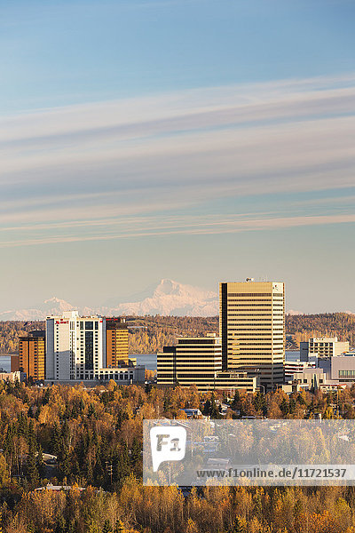 Aerial view of downtown Anchorage in autumn with Denali in the background  Southcentral Alaska  USA