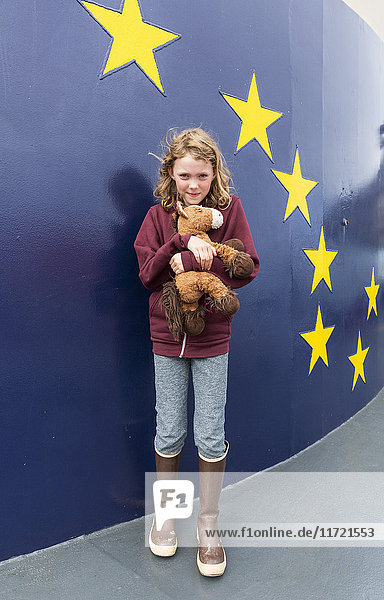 Young girl in rubber boots stands on the deck of the Alaska Marine Highway M/V Tustumena  Homer  Southcentral Alaska  USA