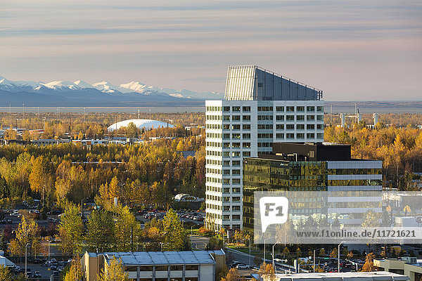 Aerial view of buildings in midtown Anchorage in autumn with Kenai Mountains in the background  Southcentral Alaska  USA