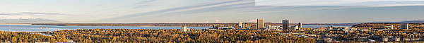 Wide aerial panorama of downtown Anchorage with Mt. Susitna  Denali  and Mt. Forager in the background  Southcentral Alaska  USA