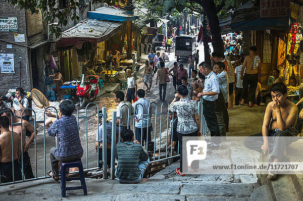 'Crowded street in an old neighborhood from Chongqing  messy and full of life where we can see the real Chinese lifestyle; Chongqing  China'