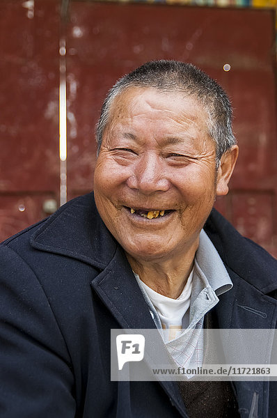 'Portrait of a Tibetan man missing many teeth in his mouth; Litang  Sichuan  China'