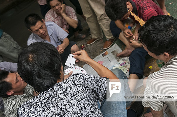 'Gambling is a ''national sport'' on the streets of China  and although gambling is not allowed by law  locals are playing cards in every corner; Chongqing  China'