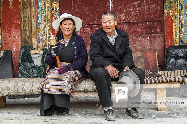 'Portrait of a Tibetan man in the big Tibetan stupa in Litang village; Litang  Sichuan province  China'