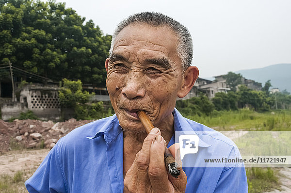 'Portrait of a senior man near the Yangtze river; Chongqing  China'