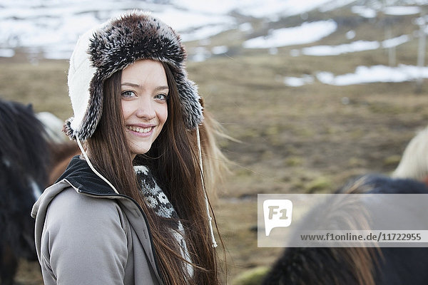 'Icelandic Woman Standing With An Icelandic Horse; Iceland'