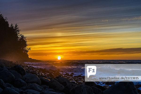 'The sun sets over the ocean on the Oregon Coast; Seaside  Oregon  United States of America'