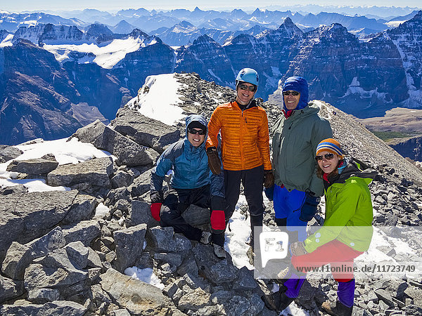 'A family posing while hiking in the Rocky Mountains; Banff  Alberta  Canada'