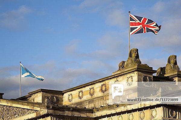 'Union Flag And Flag Of Scotland On Top Of A Building; Edinburgh  Scotland'