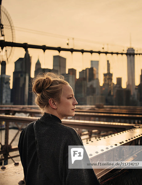 Woman looking away  cityscape in background