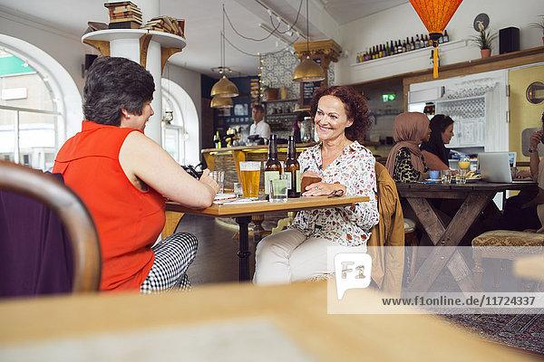 Businesswomen talking during lunch in restaurant Businesswomen talking during lunch in restaurant
