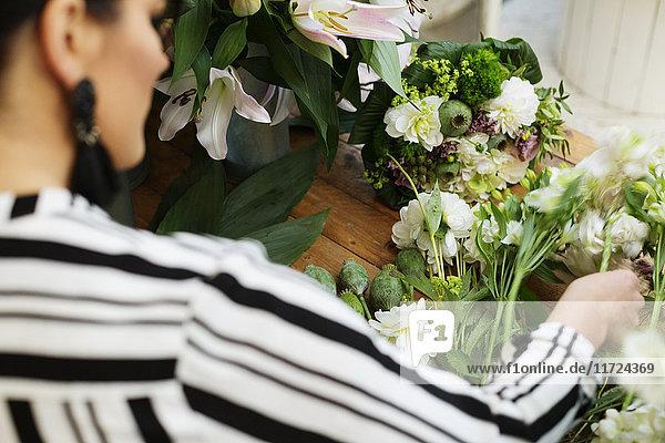 Florist making flower bouquet Florist making flower bouquet