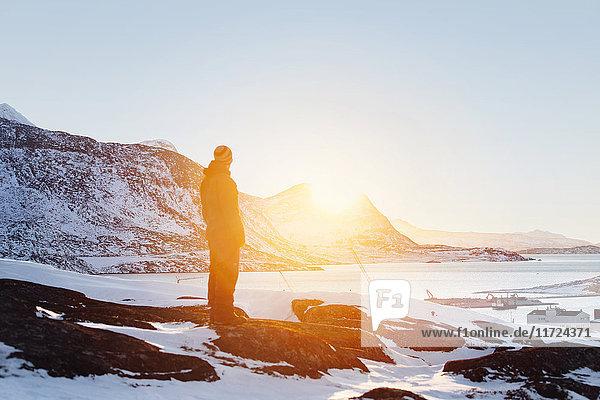 Man looking at view at sunset