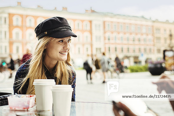 Smiling young woman sitting in cafe Smiling young woman sitting in cafe