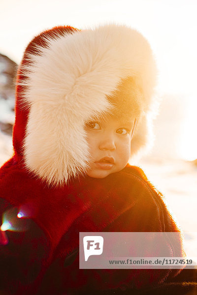 Portrait of baby boy (18-23 months) in winter coat
