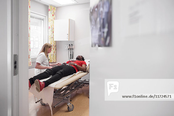 Young man with doctor during medical procedure