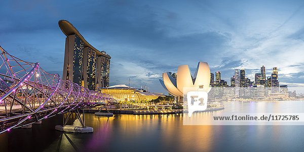Singapore  Republic of Singapore  Southeast Asia. Panoramic view of the Helix bridge  Marina Bay Sands and the ArtScience museum at dusk.