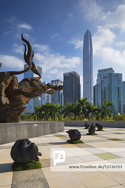 Ping An International Finance Centre (world's 4th tallest building in 2017 at 600m) and bull and bear sculptures outside Shenzhen Stock Exchange  Futian  Shenzhen  Guangdong  China