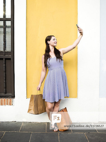 Puerto Rico  San Juan  Woman taking selfie during shopping