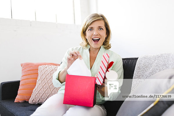 Portrait of surprised Mature woman with christmas gift