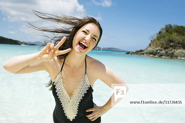 USA  Virgin Islands  Saint Thomas  Beautiful woman having fun in ocean