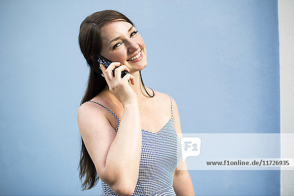 Cheerful woman during phone conversation