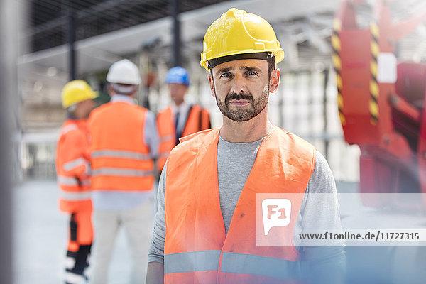 Portrait confident male construction worker at construction site