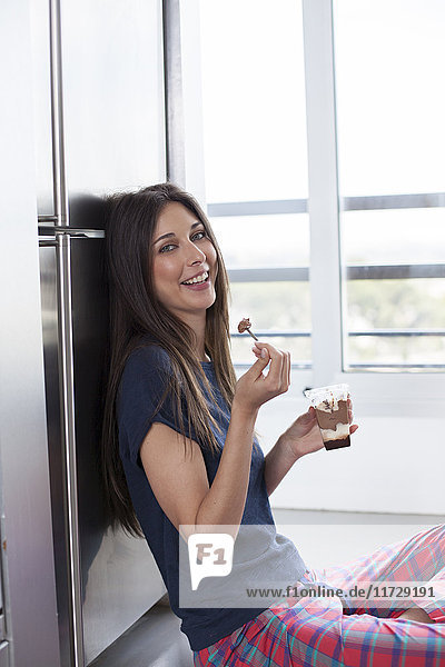 Beautiful woman eating chocolate at home