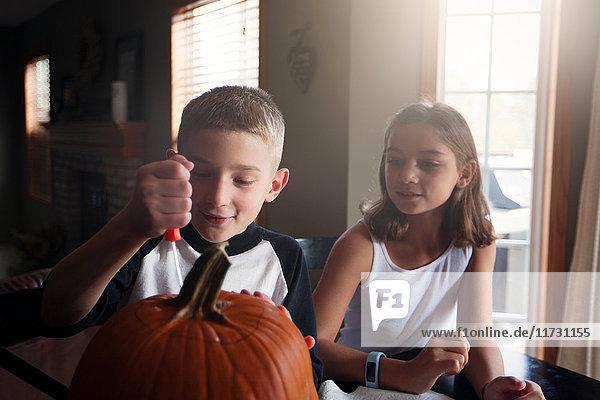 Children carving pumpkin