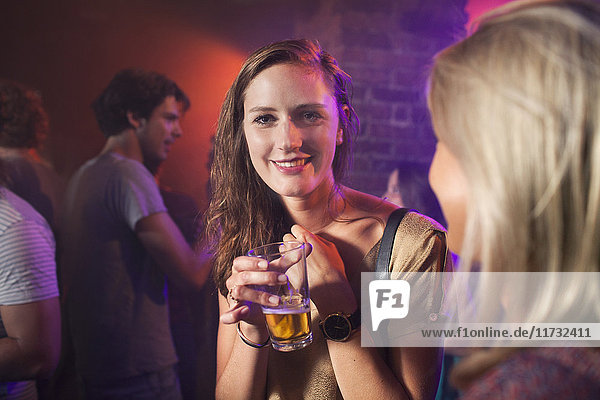 Young women celebrating in club