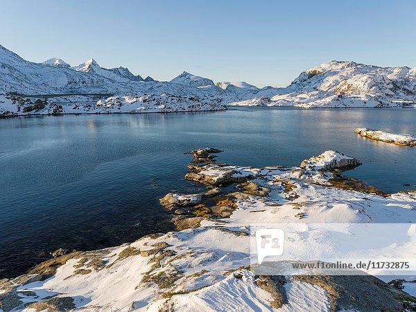 View from Flakstadoya towards Moskenesoya with the bridge over the Kakersundet. The Lofoten Islands in northern Norway during winter. Europe  Scandinavia  Norway February.