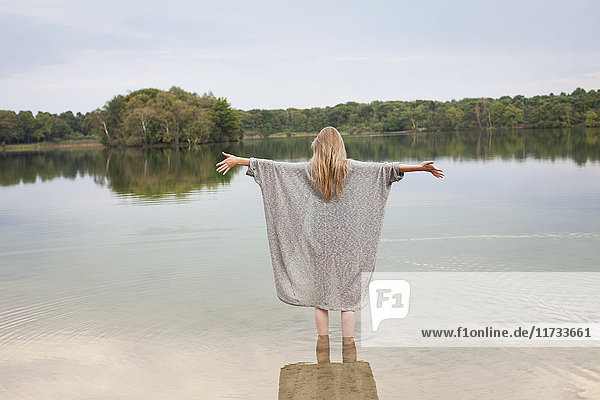Young woman standing in lake