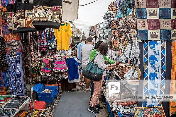 Shoppers are browsing handmade items at an open market in downtown Cape Town  South Africa.