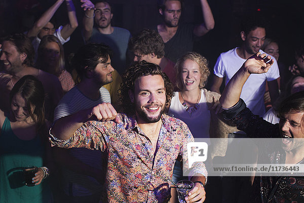 Group of friends celebrating in club