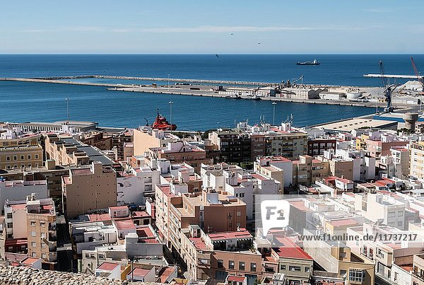 View from the fortress of Moorish houses and buildings along the port of Almeria  Andalusia  Spain.