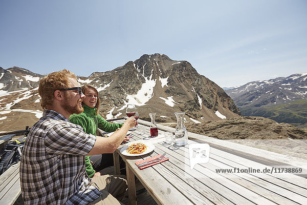 Young couple having wine with meal outdoors  Val Senales Glacier  Val Senales  South Tyrol  Italy
