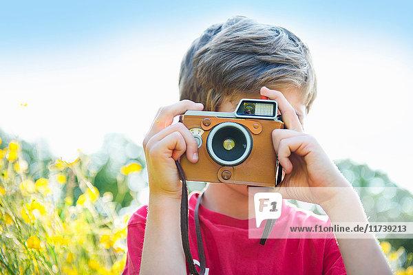 Boy taking photograph
