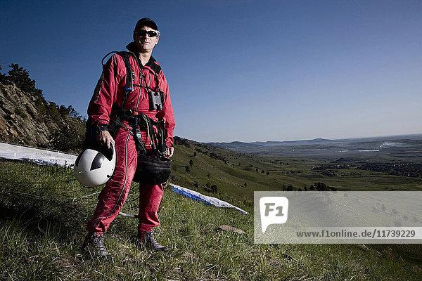 Portrait of male paraglider on hillside  Boulder  Colorado  USA