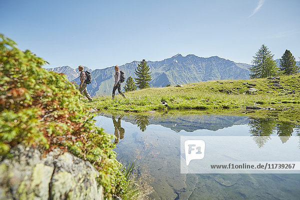 Young hiking couple near lake  Karthaus  Val Senales  South Tyrol  Italy