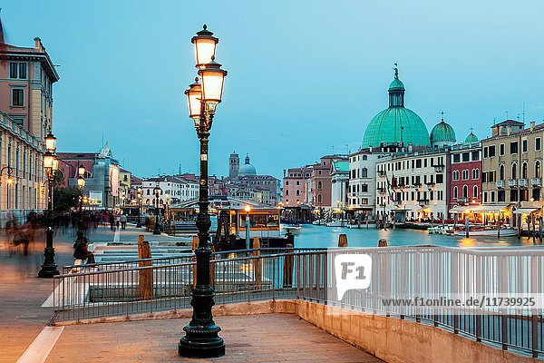Dusk on Grand Canal in Venice. Skyline of Santa Croce district in the distance.