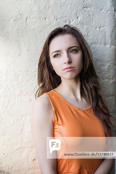 Beautiful young woman looking away.
