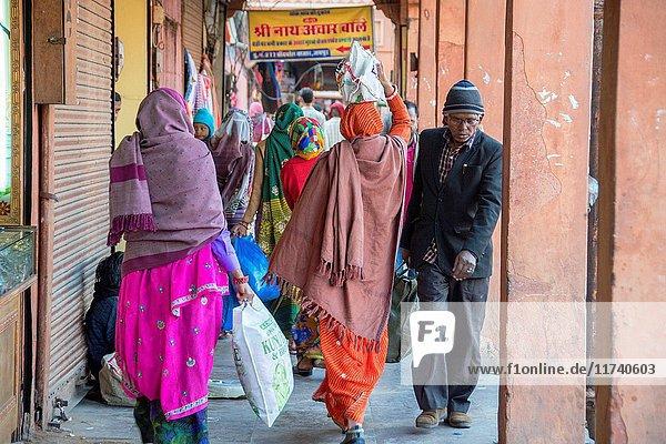 Johri Bazaar  Indian people walking down crowded street in Jaipur  India.