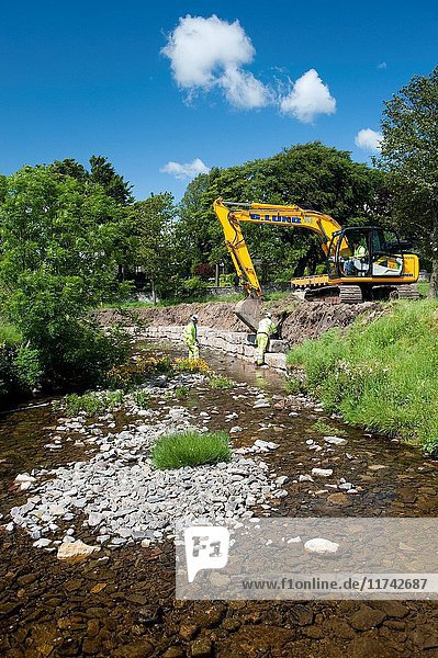 Improving river bank on stream to help prevent flooding. (Photo by: Wayne Hutchinson/Farm Images/UIG)