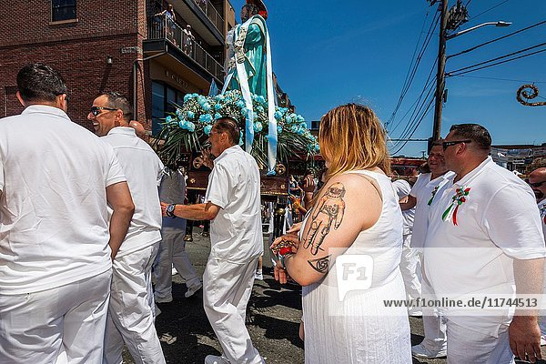 USA  Massachusetts  Cape Ann  Gloucester  St. Peter's Fiesta  Italian-Portuguese fishing community festival  religious procession  woman with astronaut tattoo.
