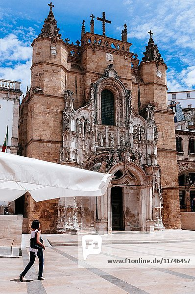 Young woman walking by main façade of Santa Cruz church  Coimbra  Portugal.