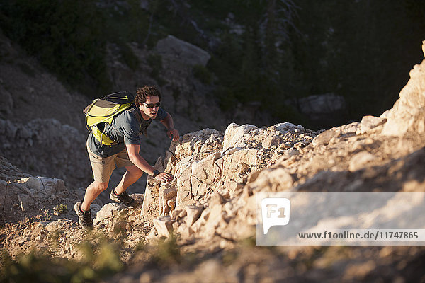 Hiker climbing  Sunset Peak trail  Catherine's Pass  Wasatch Mountains  Utah  USA